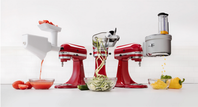 KitchenAid® stand mixers shown with different hub attachments in use.
