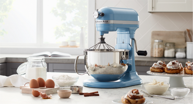 Preparing to whisk flour in a KitchenAid® stand mixer.