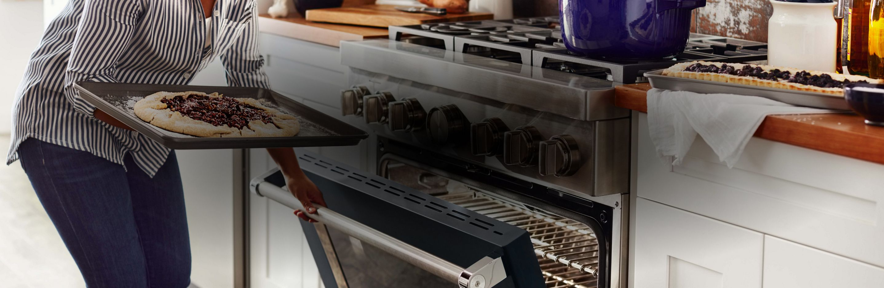 Putting pizza in a KitchenAid® range.