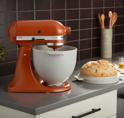 A Tilt-Head Stand Mixer with the Bread Bowl with Baking Lid.