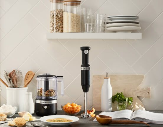 A kitchen counter featuring a Matte Black Cordless Chopper and Hand Blender.
