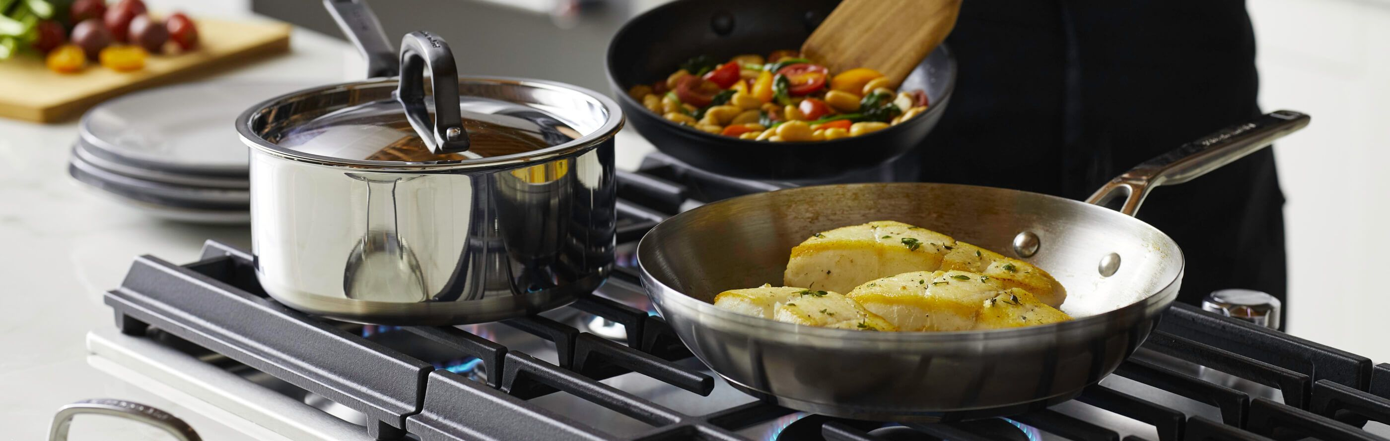 KitchenAid® Cookware being used over a stove.