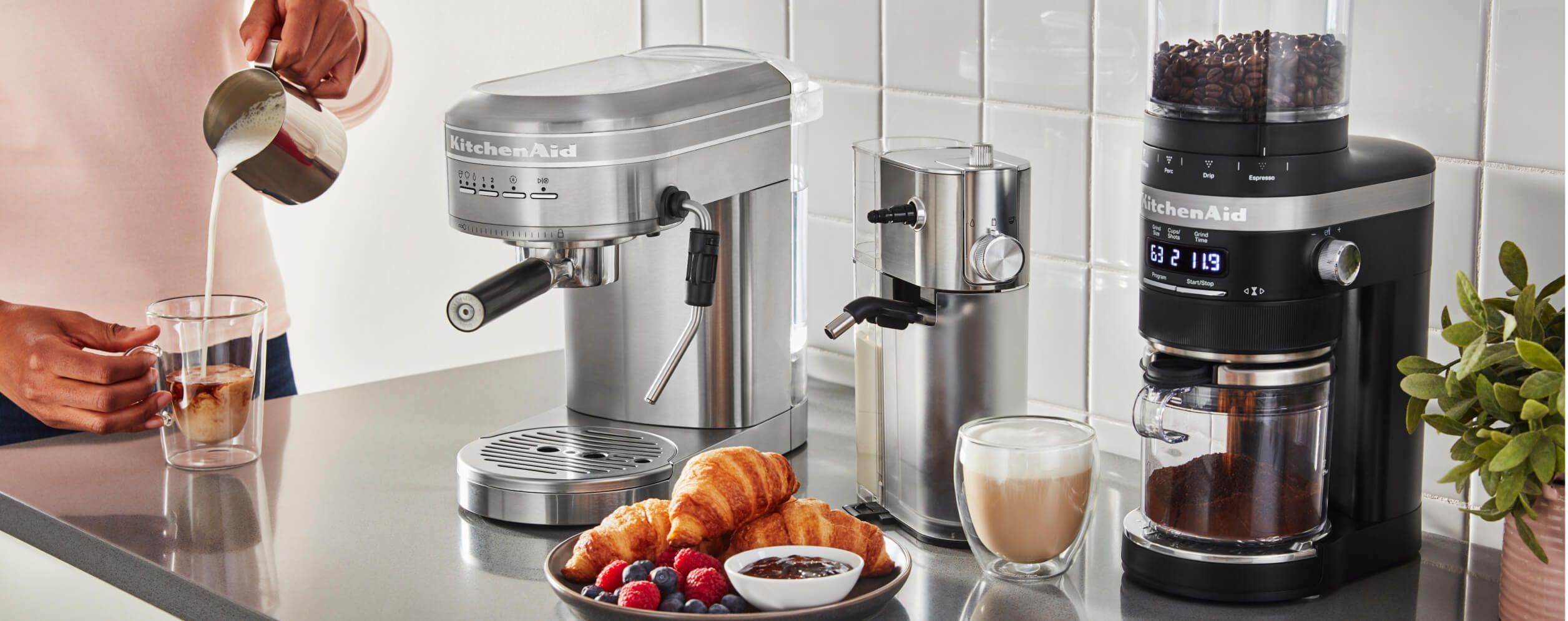 A KitchenAid® Espresso Machine and Burr Coffee Grinder resting on a counter.