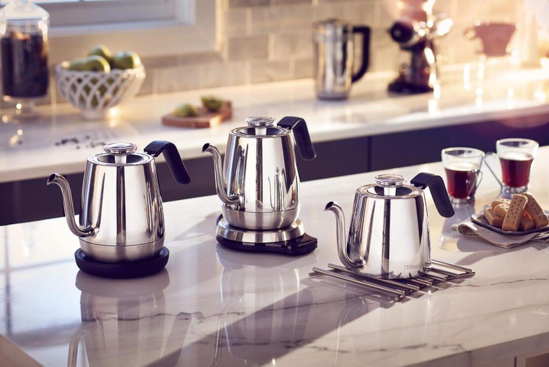 Three KitchenAid® Precision Gooseneck Kettles resting on a kitchen counter.