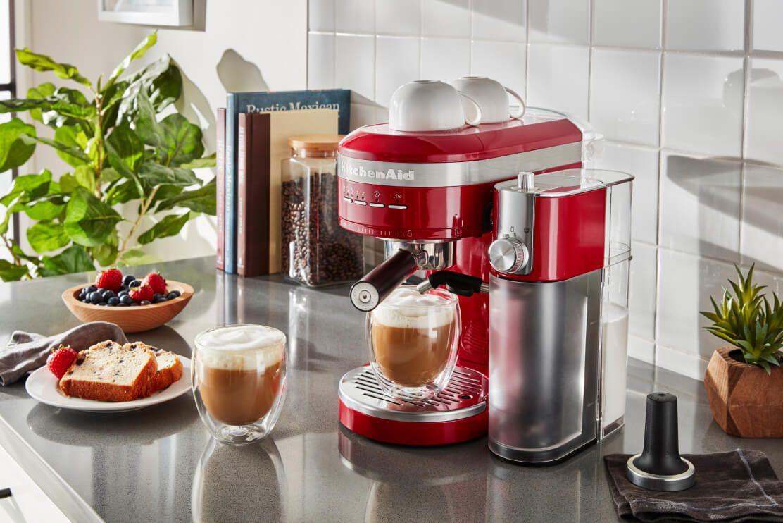 A KitchenAid® Semi-Automatic Espresso Machine with Automatic Milk Frother Attachment in Empire Red.