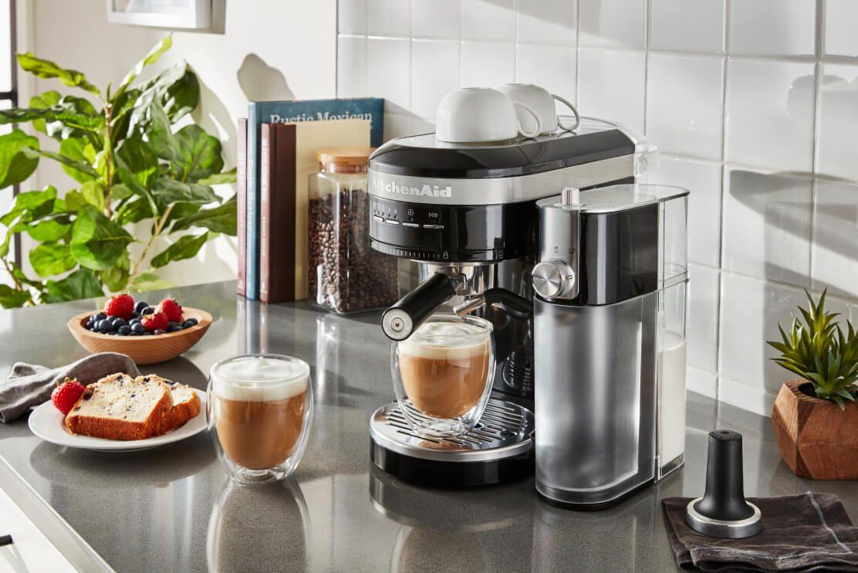 A KitchenAid® Semi-Automatic Espresso Machine with Automatic Milk Frother Attachment in Black.