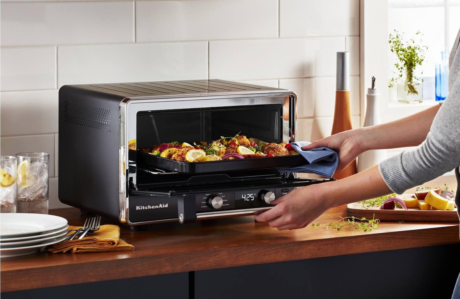 A KitchenAid® Digital Countertop Oven roasting vegetables.