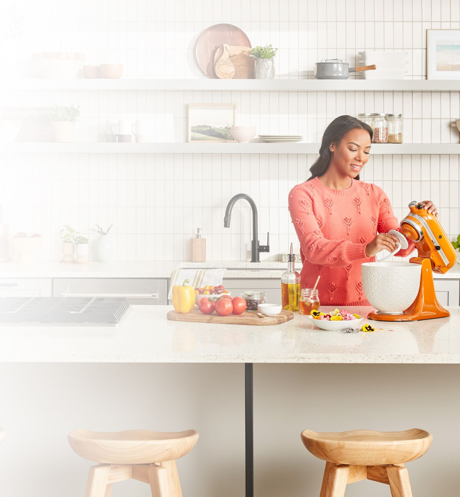 Woman with KitchenAid® Artisan® Series Stand Mixer and fresh vegetabes