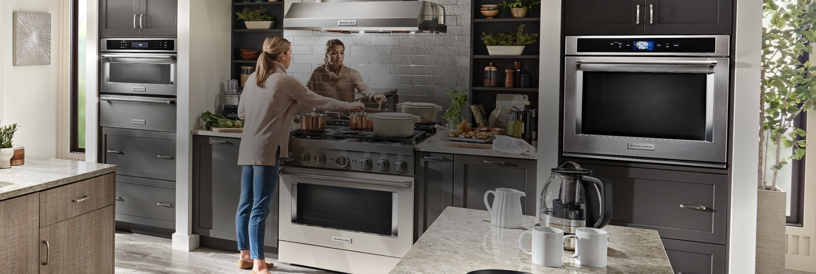 Cooking in a fully equipped KitchenAid® kitchen.