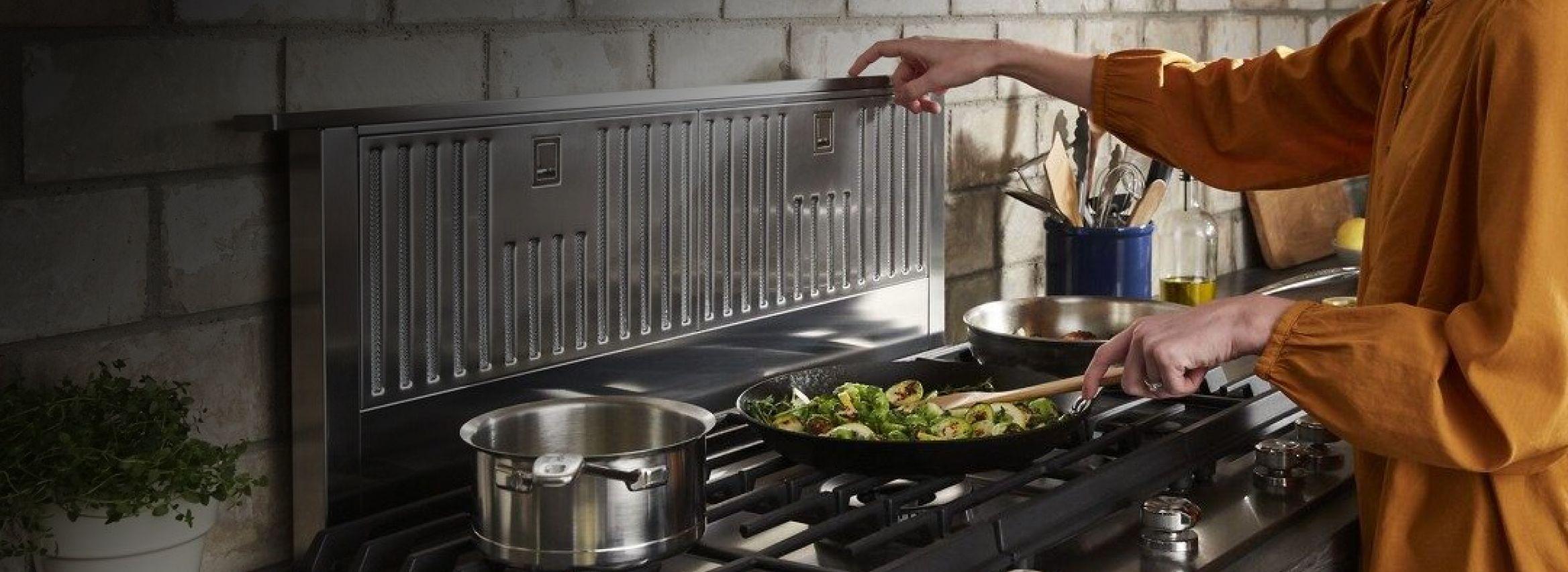Cooking on a KitchenAid® range.