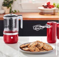 KitchenAid® cordless countertop appliances, shown with a plate of cookies.