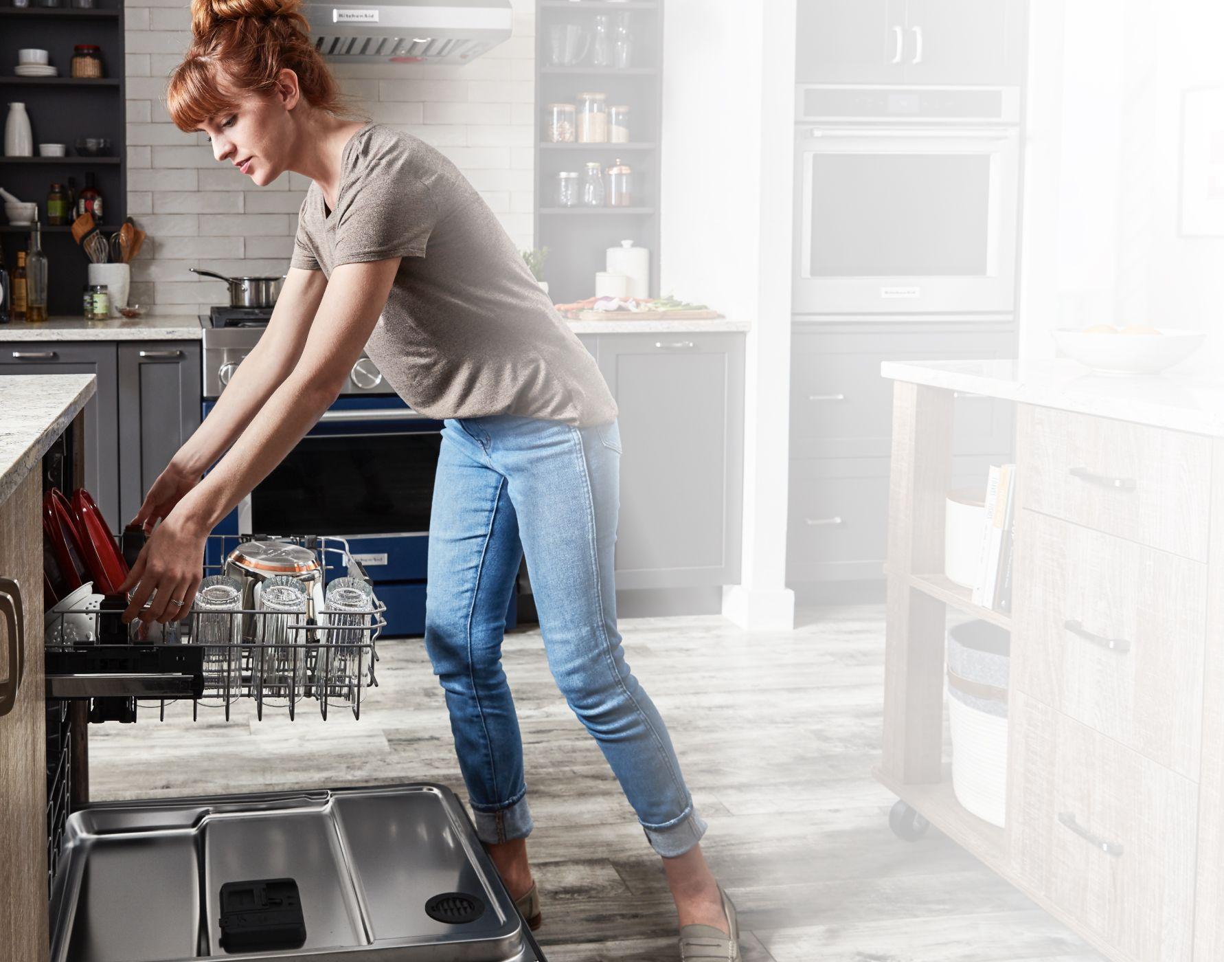 A person unloading their FreeFlex™ Third Rack Dishwasher.