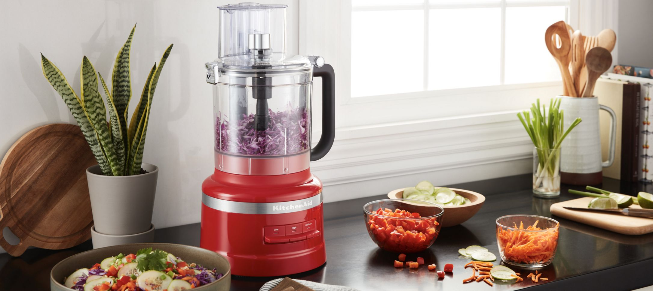 A 13 Cup Food Processor holding red cabbage.
