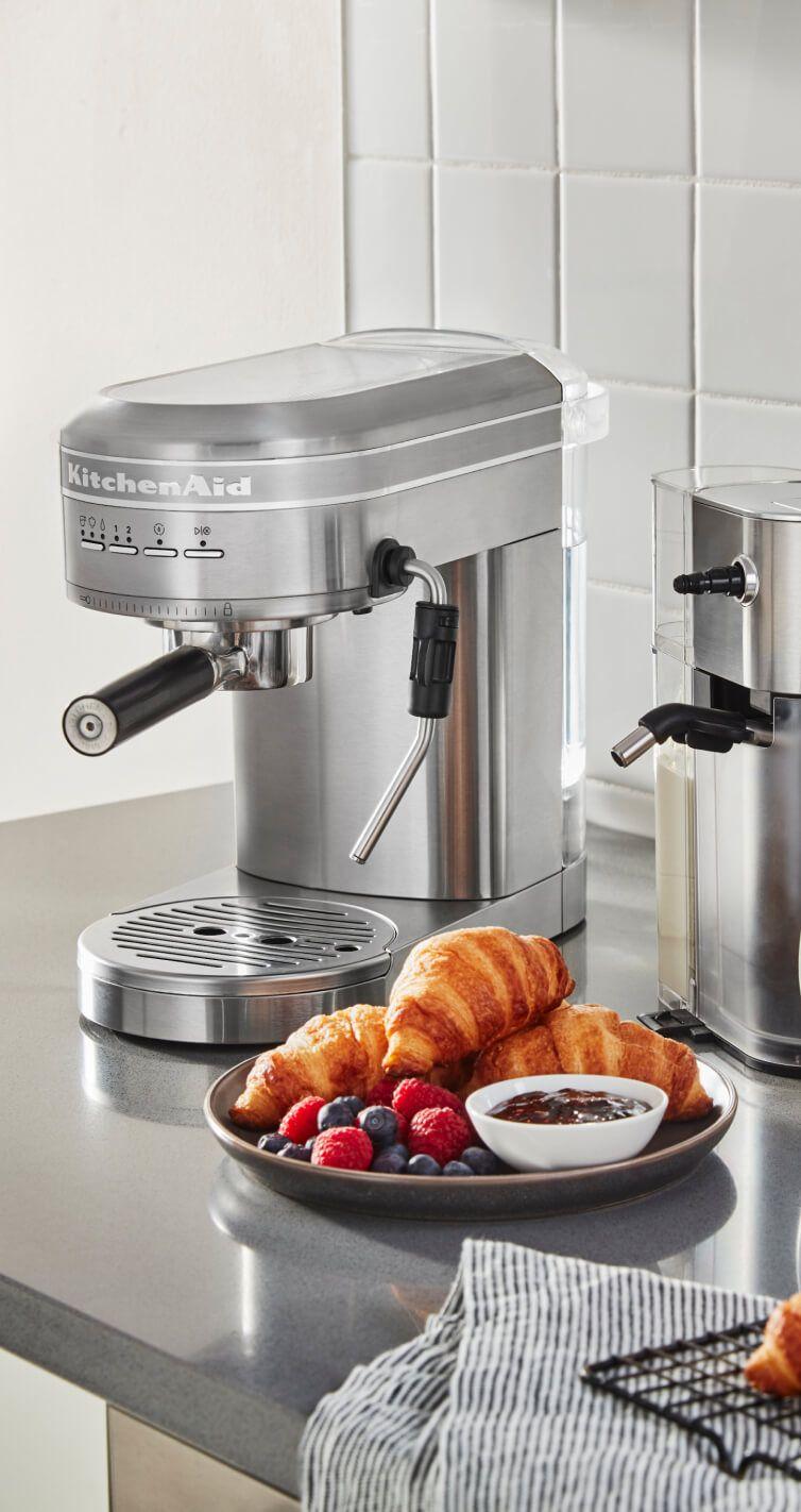 A KitchenAid® Semi-Automatic Espresso Machine with Automatic Milk Frother Attachment.