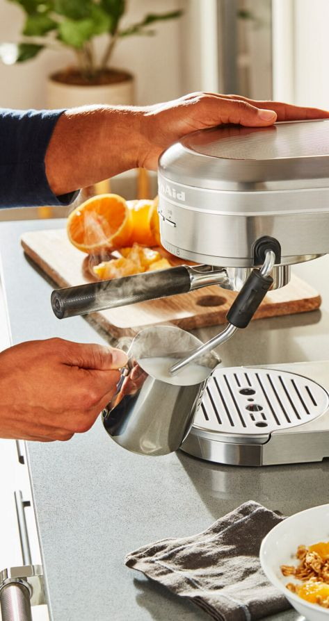 A person using the Automatic Milk Frother Attachment.