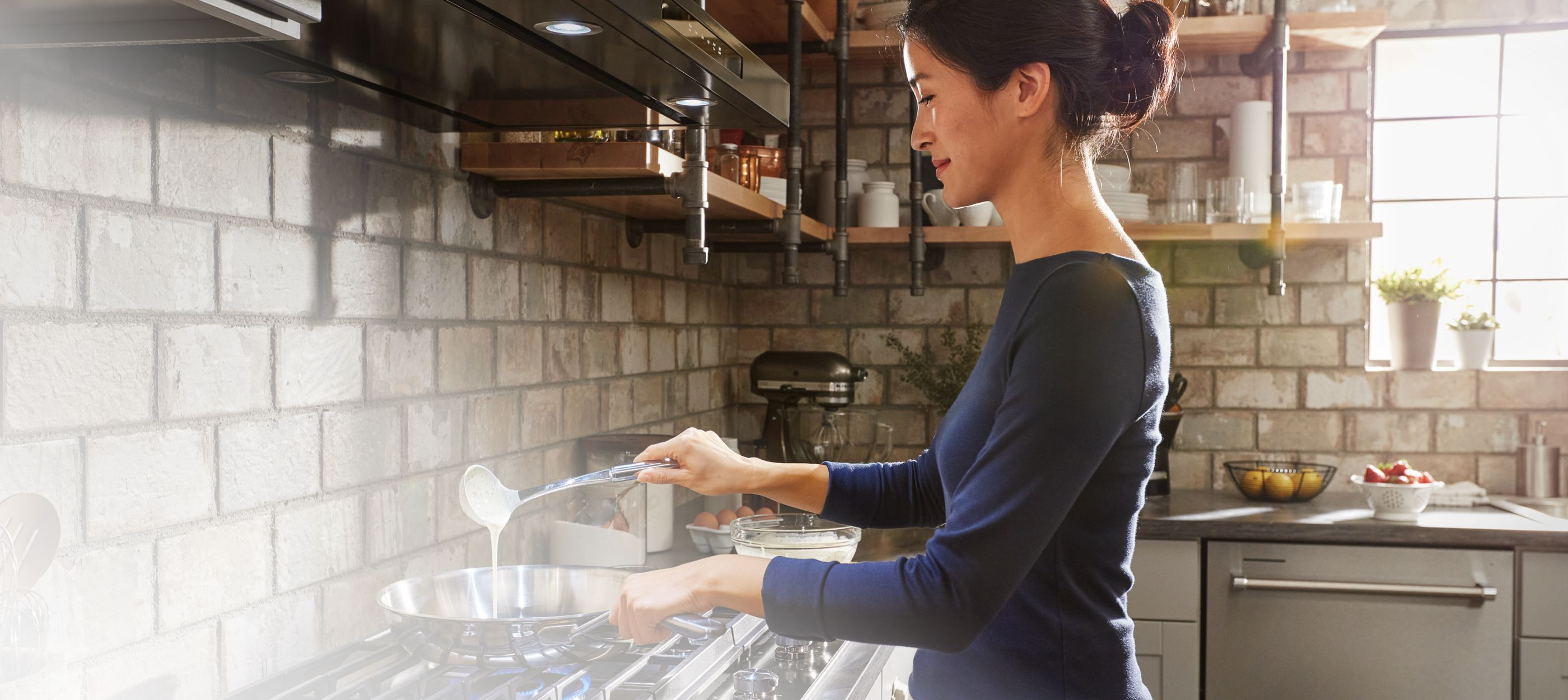 Cooking on a KitchenAid® cooktop.