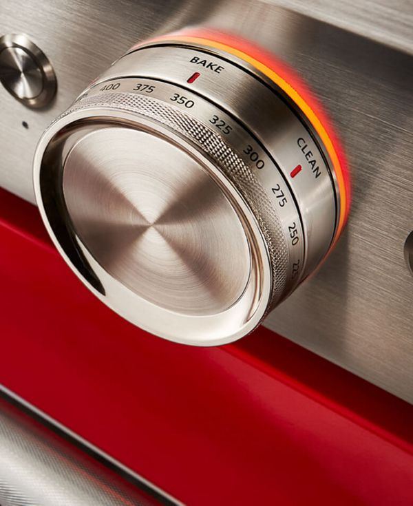 Close-up of passion red range showing temperature dial.
