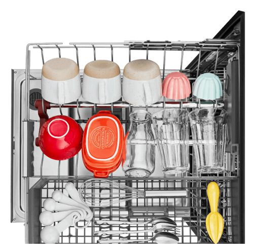 An overhead shot of a fully extended dishrack loaded with assorted dishes of varying bold colors.