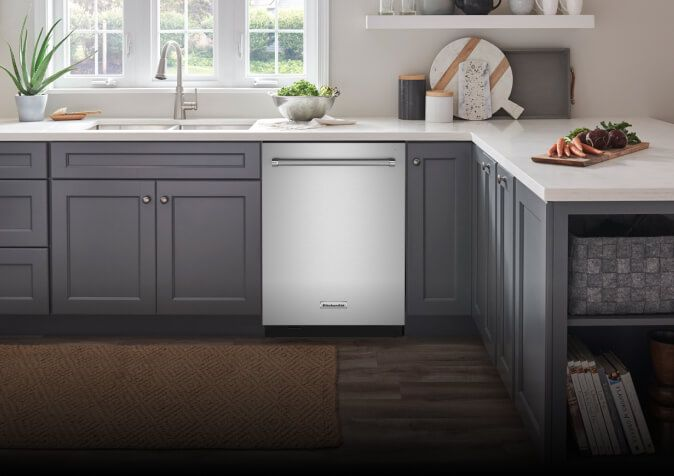 A stainless steel FreeFlex™ Third Rack Dishwasher equipped in a bright, fully stocked kitchen.