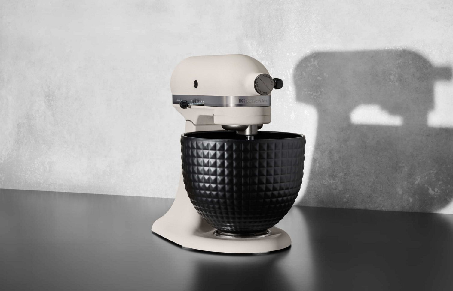 A stand-alone Limited Edition Stand Mixer with a black ceramic studded bowl.