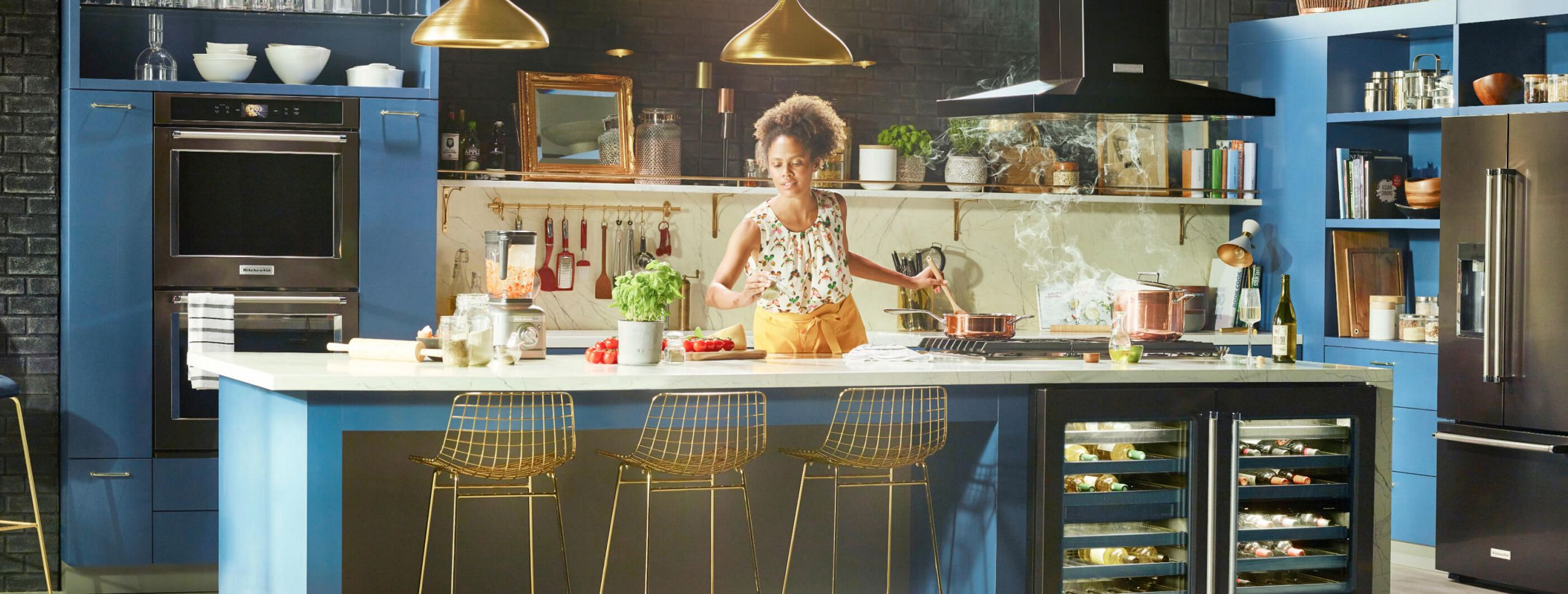 A woman diligently making in her clean, bright kitchen.