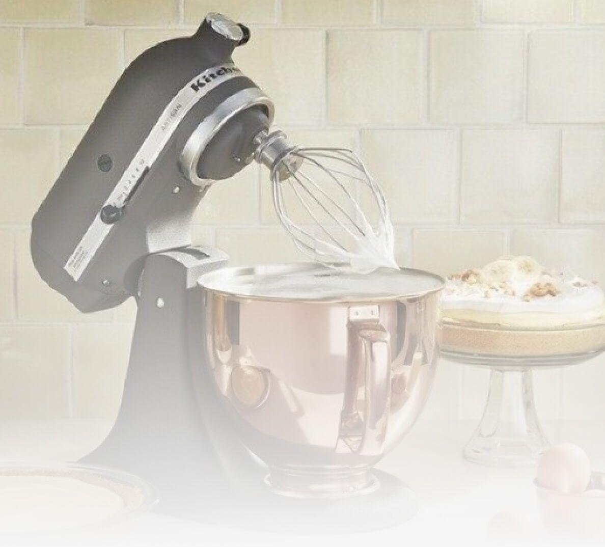 A KitchenAid® Matte Black Stand Mixer with a copper bowl.