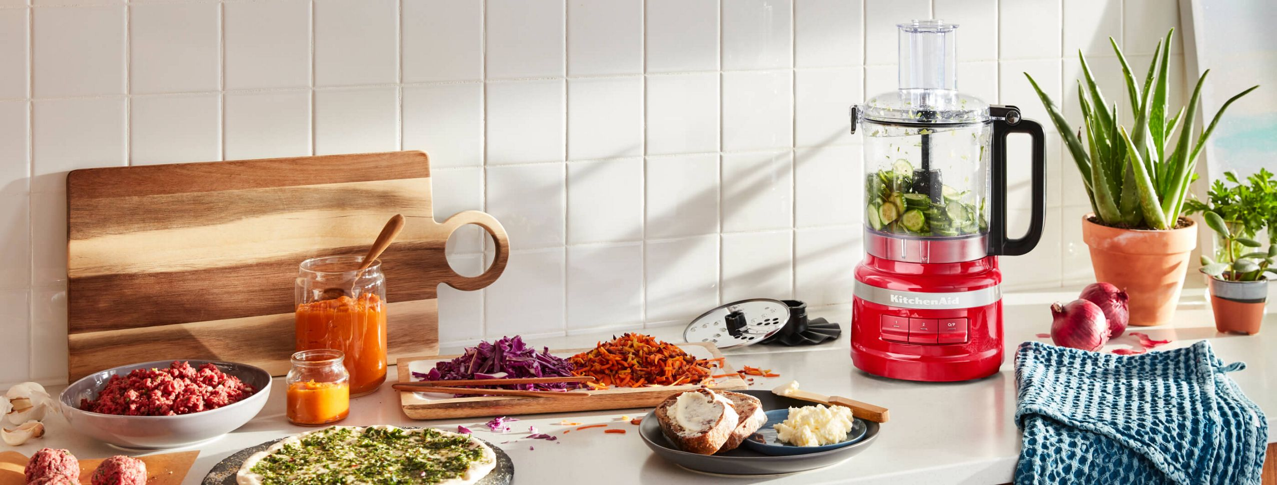 An Empire Red 9 Cup Food Processor on a kitchen counter.