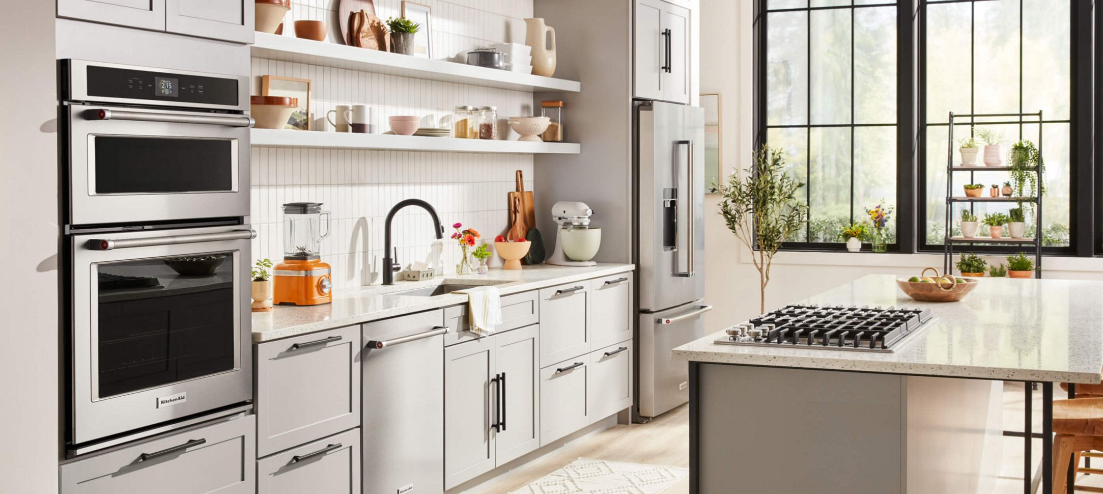 A clean kitchen with a variety of KitchenAid® products.