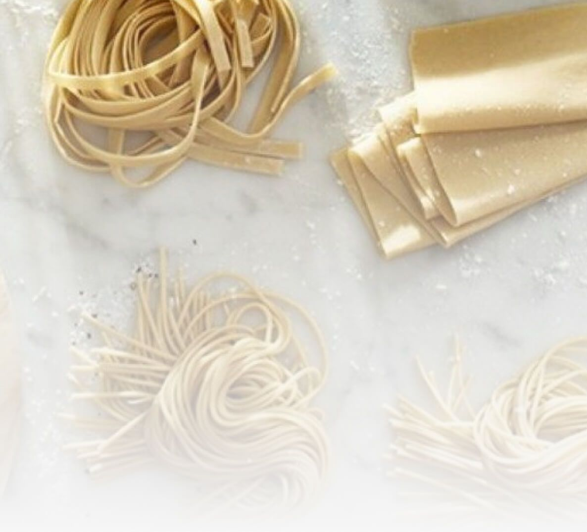 A variety of pastas resting on a kitchen countertop.