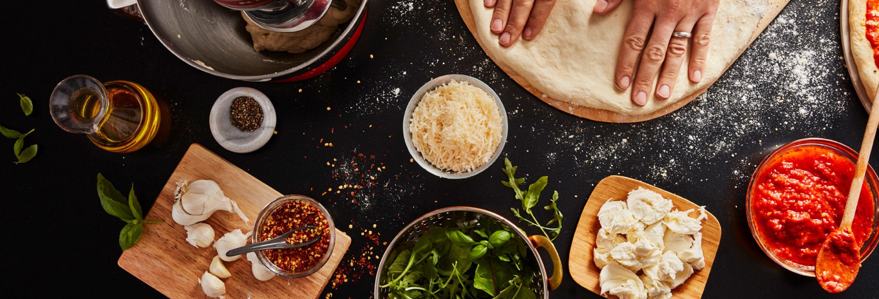 Preparing flatbread pizza with a KitchenAid® Stand Mixer.