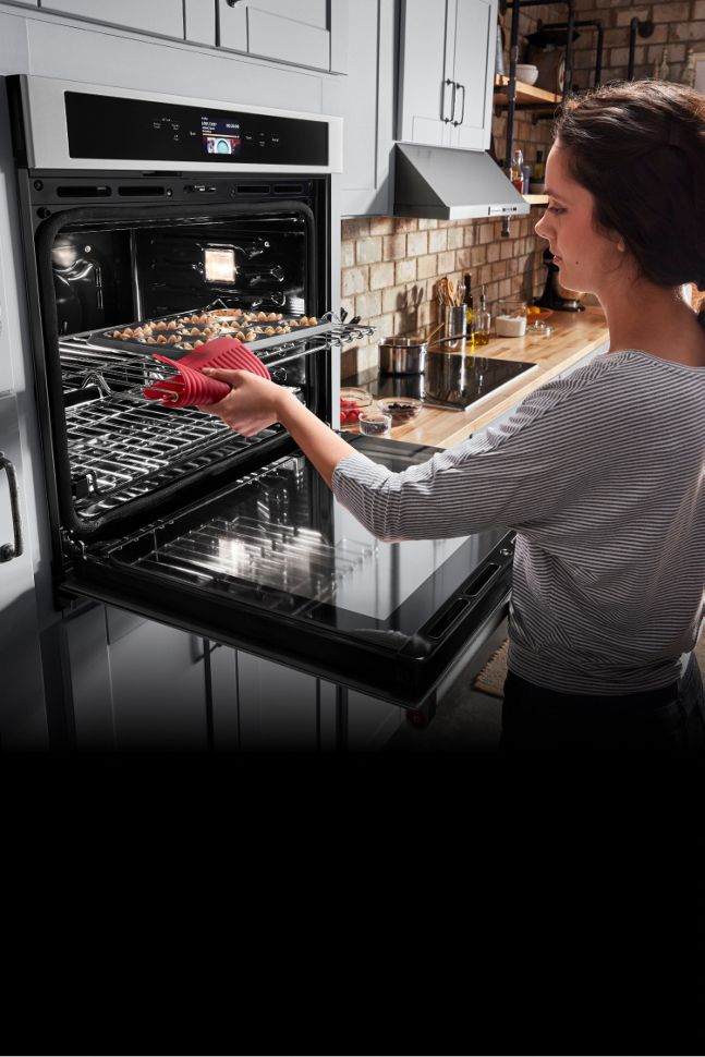 Cooking in a KitchenAid® wall oven.