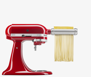 Red Stand Mixer cutting freshly made pasta.