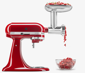 Red stand mixer with grinder attachment grinding freshly-ground meat.