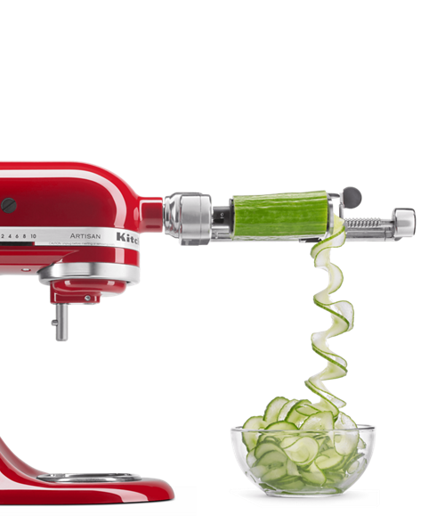Red stand mixer beautifully spiralizing a fresh cucumber.