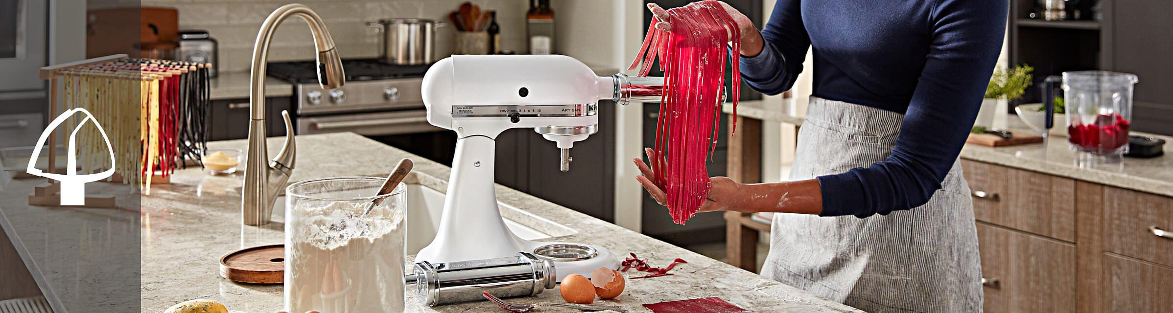 Person using a KitchenAid® pasta attachment