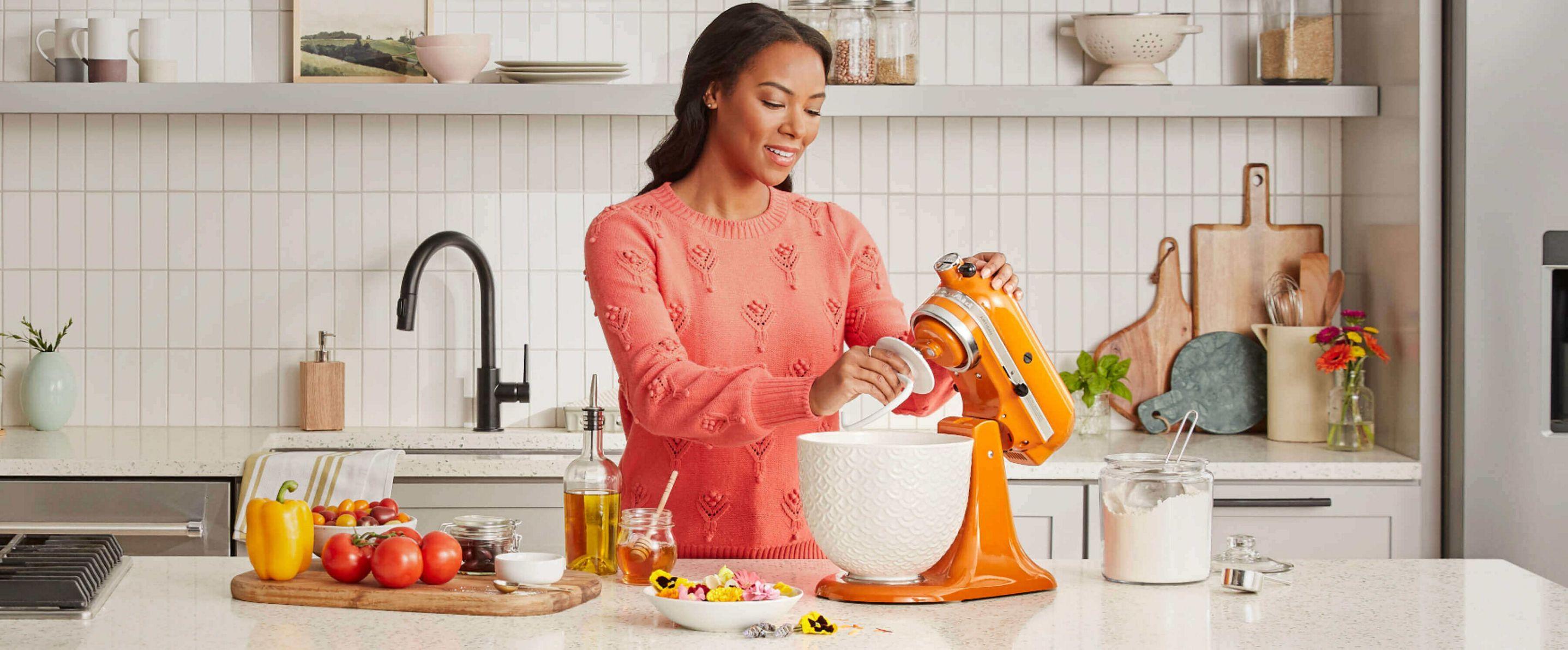 A person baking using a KitchenAid® stand mixer