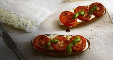 Plate with tomatoes and mozzarella cheese on toast.