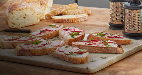 Plate of radish and cheese on toast.