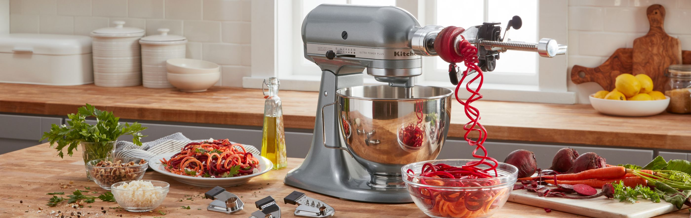 KitchenAid® Stand Mixer w/attachment making beet noodles.