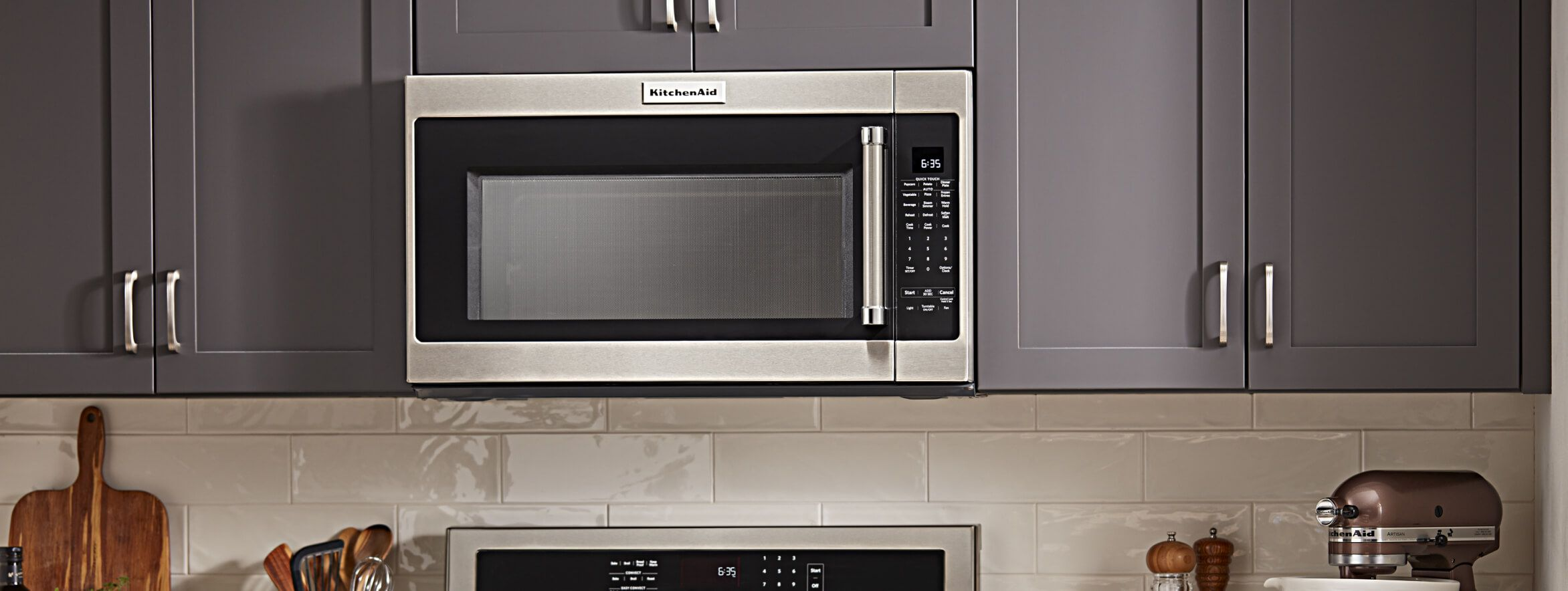 Over-the-range microwave in grey cabinets