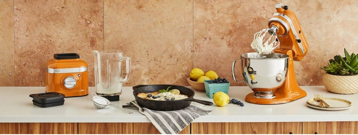 Cast iron pan on a counter with a KitchenAid® Blender and Stand Mixer in Honey