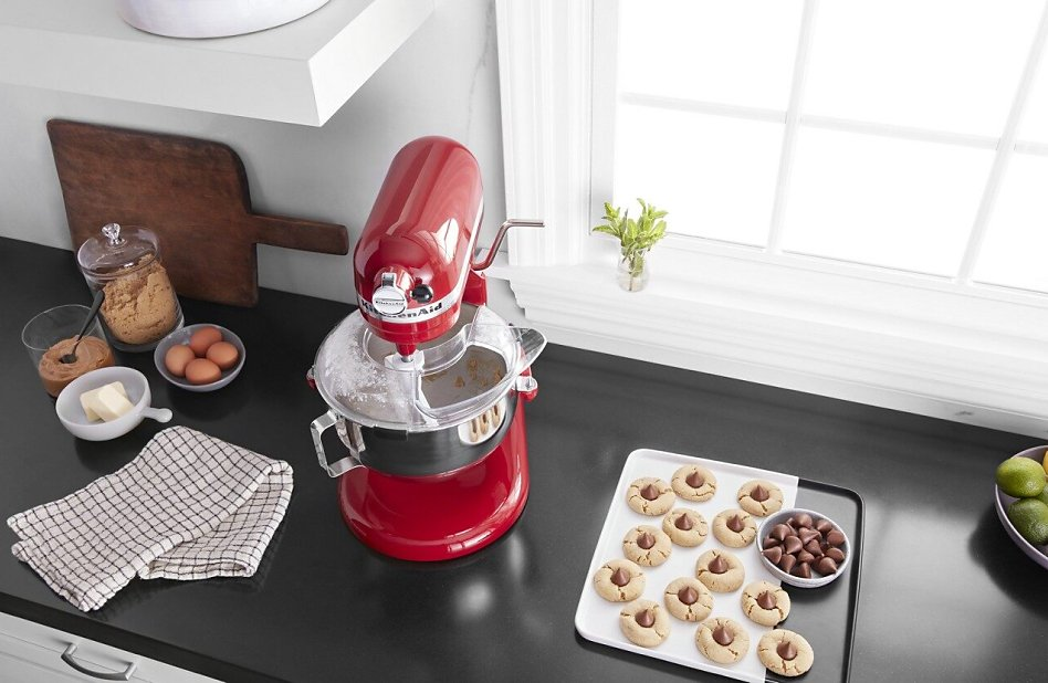 KitchenAid® stand mixer on countertop with plate of homemade cookies.