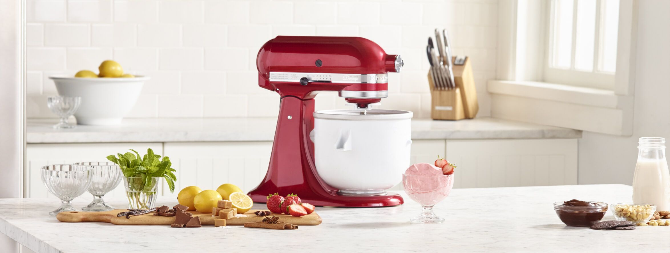 Ingredients for making homemade frozen yogurt in a KitchenAid® stand mixer.