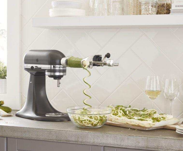 KitchenAid® stand mixer with Spiralizer Attachment spiralizing veggies