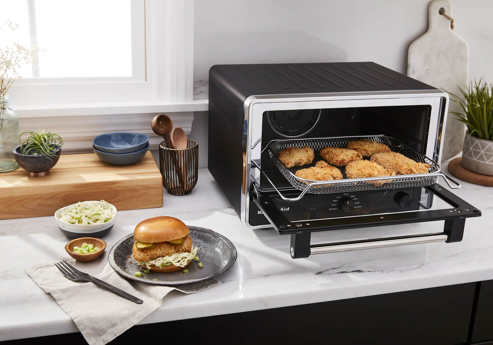 KitchenAid® Digital Countertop Oven with air fried chicken.