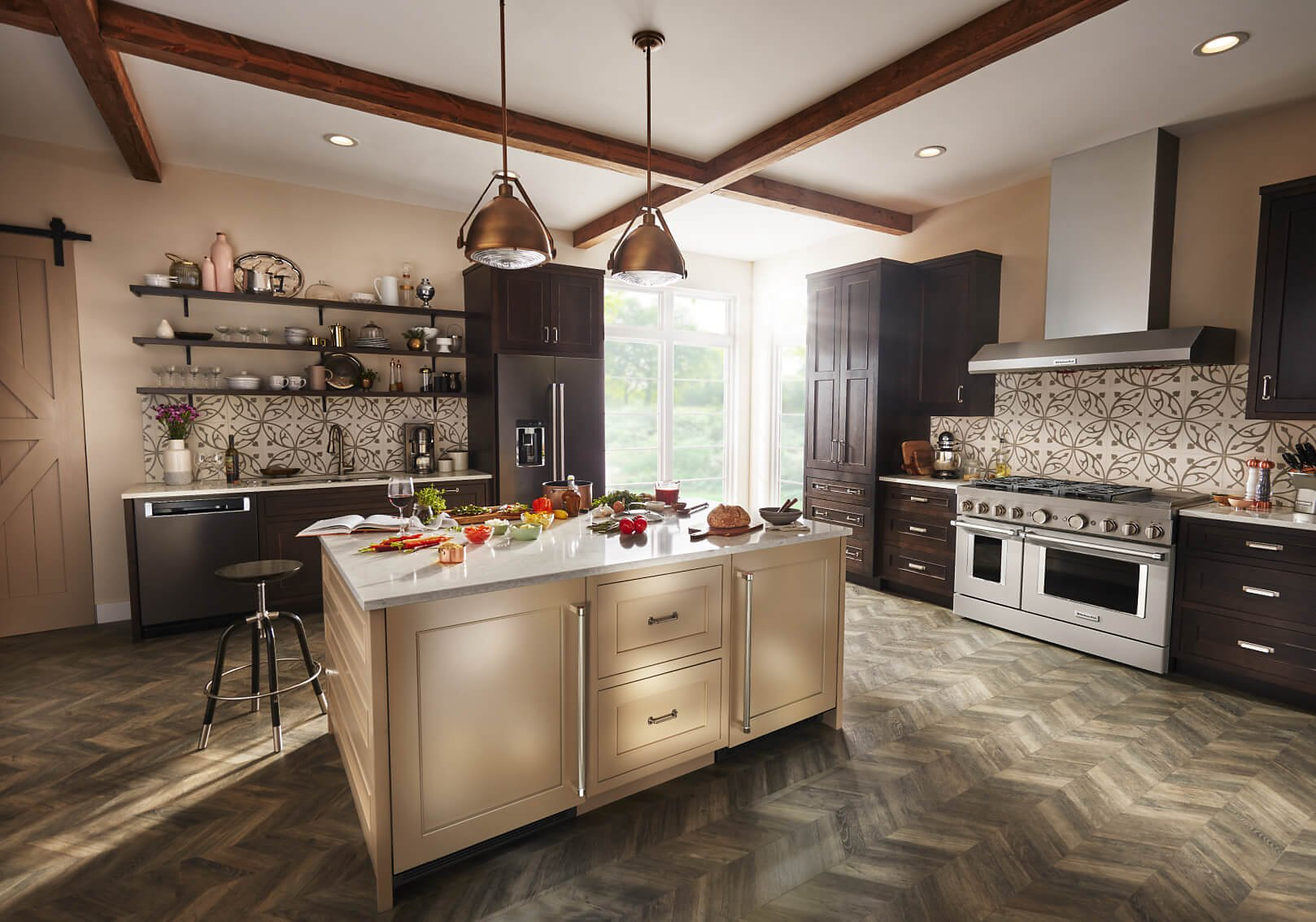 Kitchen with large island and black stainless KitchenAid® appliances.