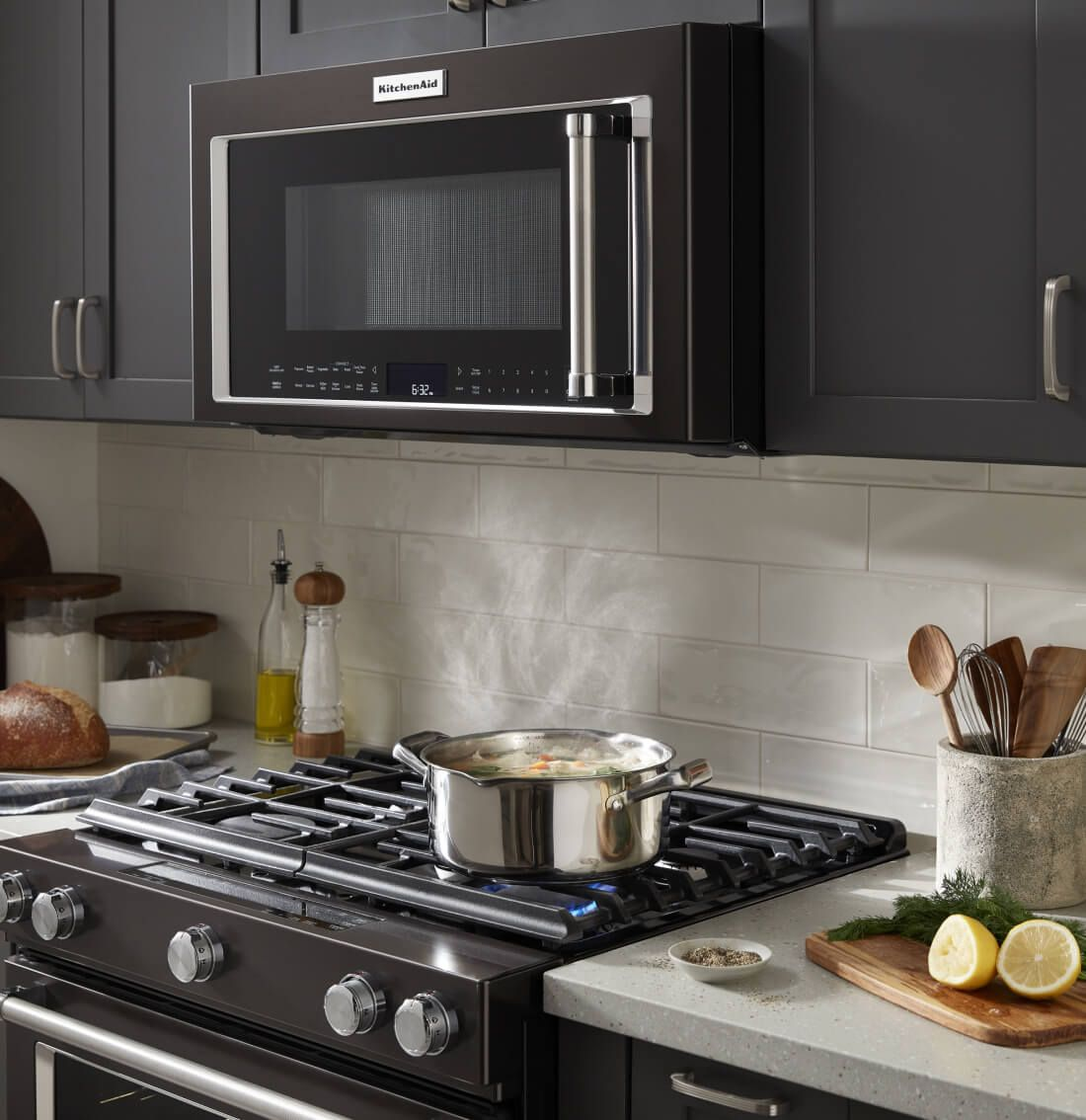 Black microwave hood combination in a black kitchen