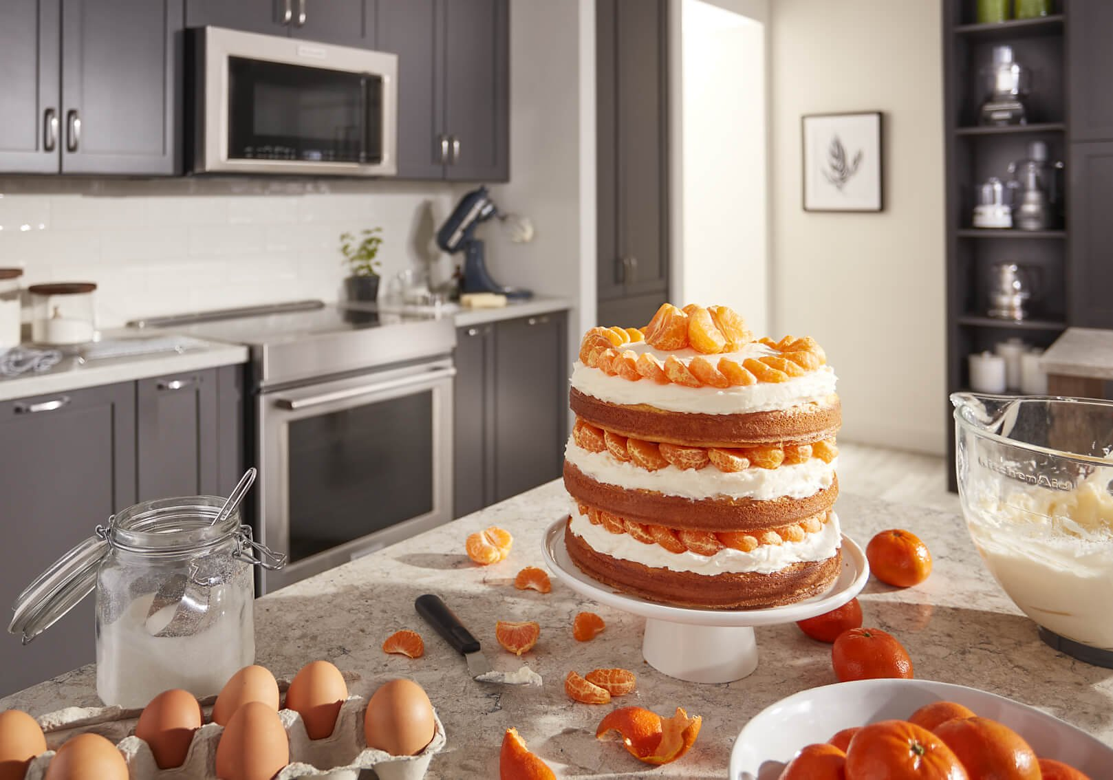 A layered cake with tangerines and cream