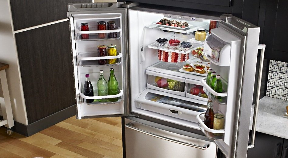Open French door refrigerator stocked with food and drinks