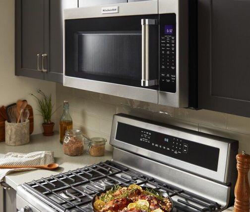 KitchenAid® microwave range hood over a freestanding range